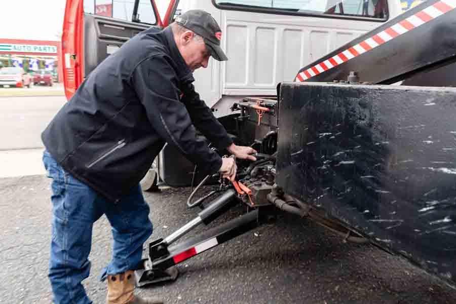 Commercial Roofing Contractor stabilizing equipment truck.