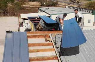 Weathershield Roofing Contractors Working on a Commercial Business Roof.
