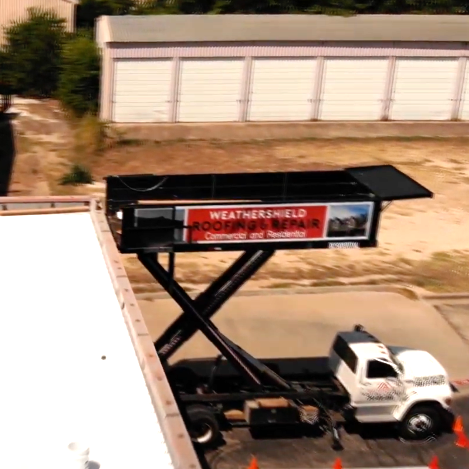 Truck and Crew loading supplies on top of a building