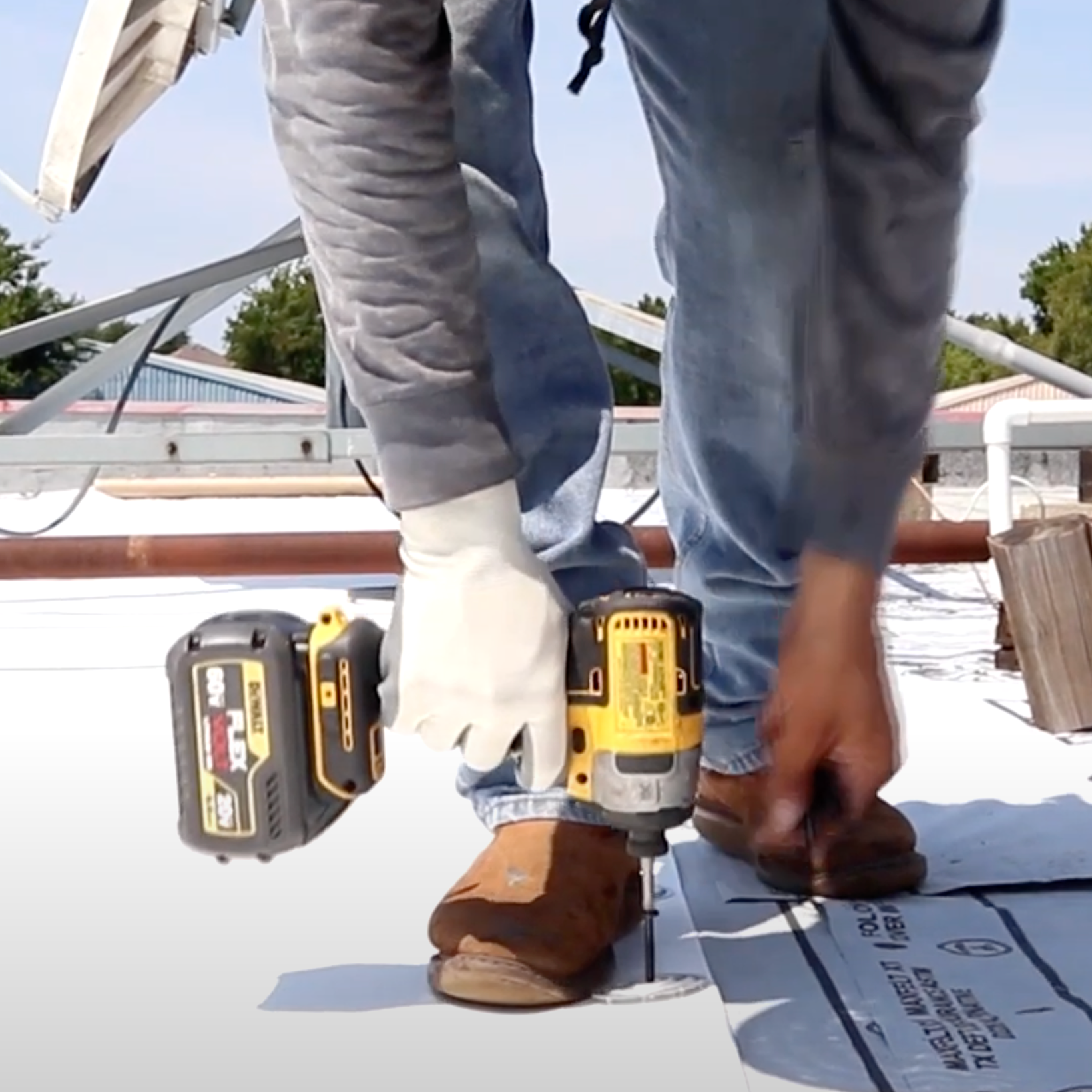 Repairing a business roof.
